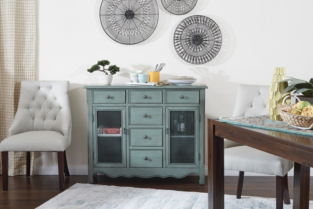 The Ashfield storage console evokes the charm of a vintage pie safe with its screened in storage cabinet doors. A must have for the farmhouse kitchen!