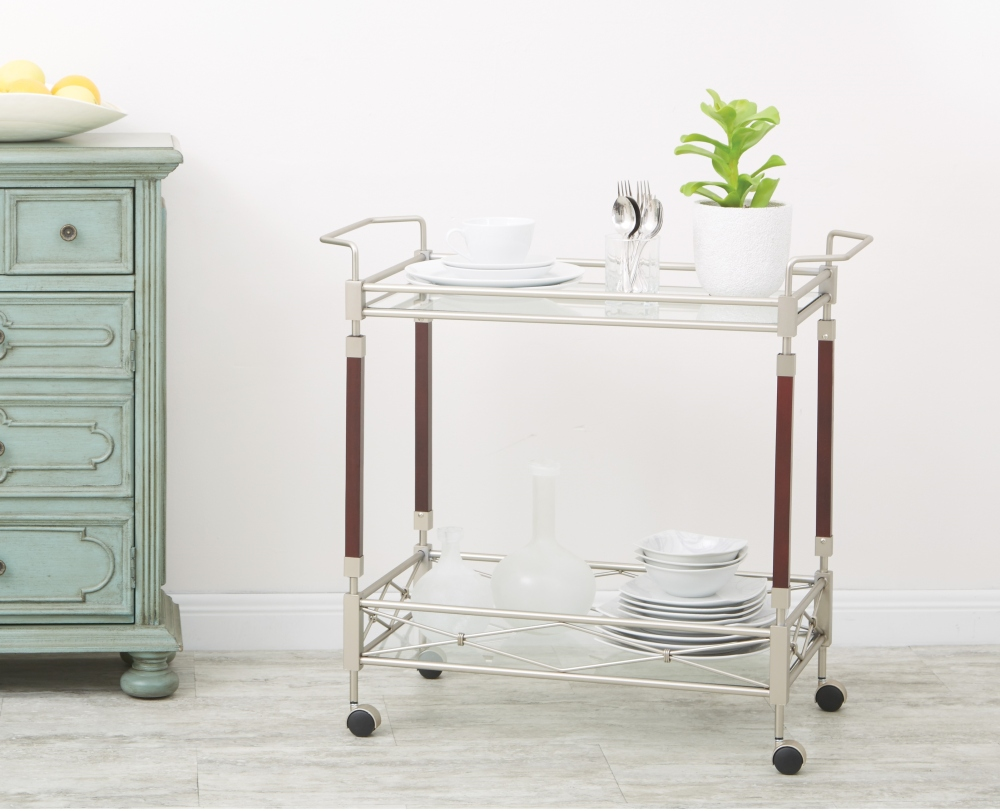 Who says that bar carts can only be used for drinks when entertaining? They also make excellent storage areas for plates and silverware.