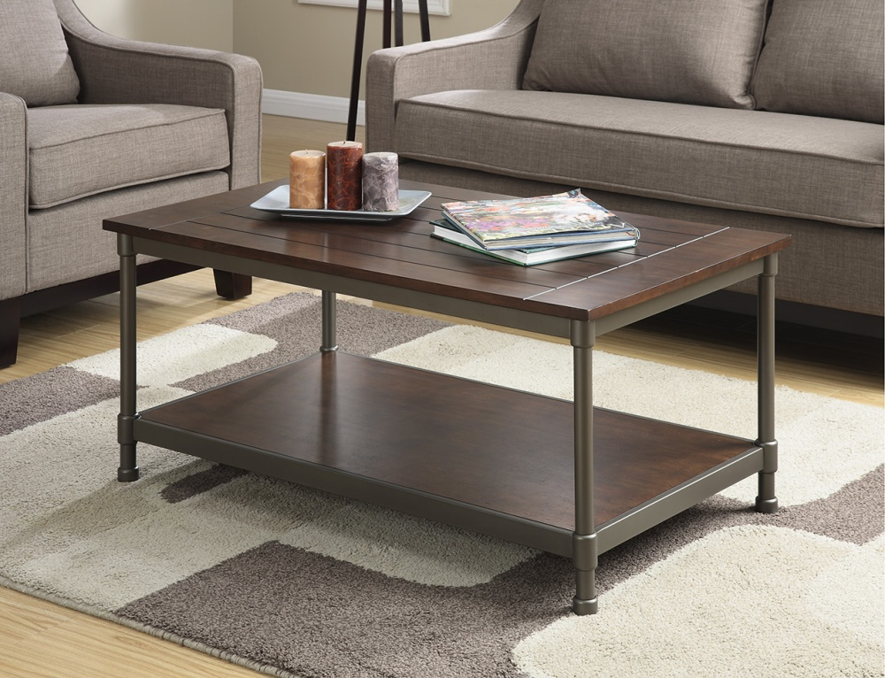 Inspired by the industrial solid plank work stations of a century ago, this well worn wood and cast metal coffee table will add a worthy statement to your living room. Boasting a finish of walnut and oiled pewter.