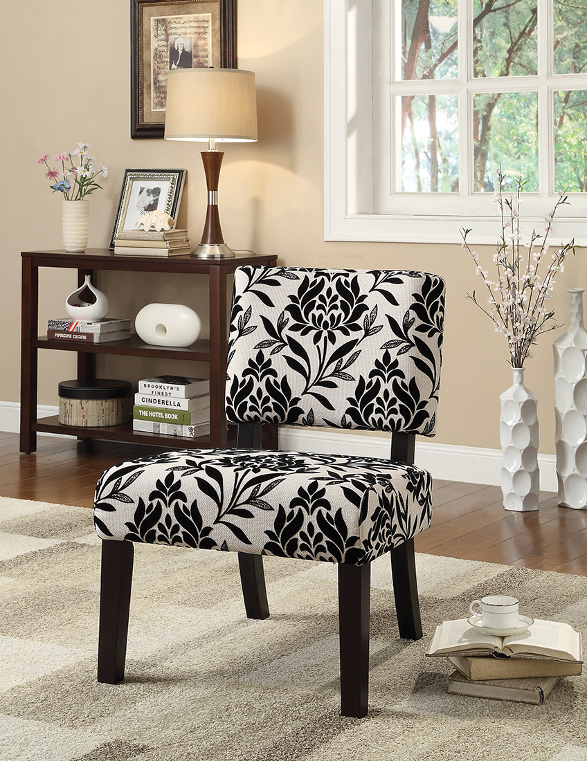 Is your living room lacking color and character? Adding an accent chair with a bold fabric and a unique shape creates instant drama.