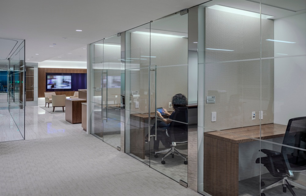 How Work Modes Impact Modern Workplace Design – Part 1: Focus. The 'workplace of the future' at the Strategy& office in Washington, D.C. incorporates hoteling stations, private areas where employees can go for focus work.