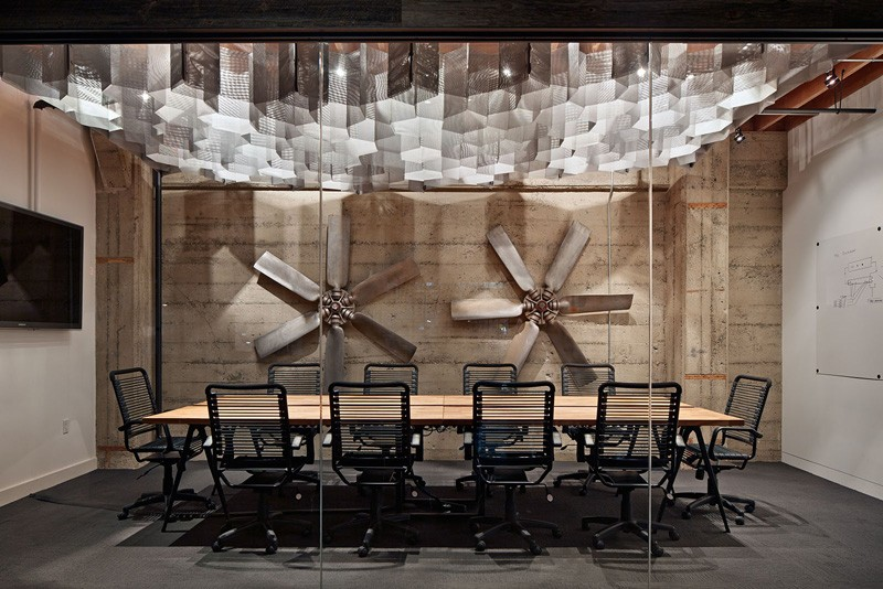 The formal boardroom at Heavybit Industries pays homage to the industrial past of this former warehouse, turned office, in the SoMa District of San Francisco.