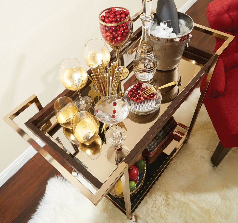 This holiday season we are loving the mixed metal vibe of the OSP Designs Isabella wine cart. The dramatic style exudes holiday glamour without breaking your budget.