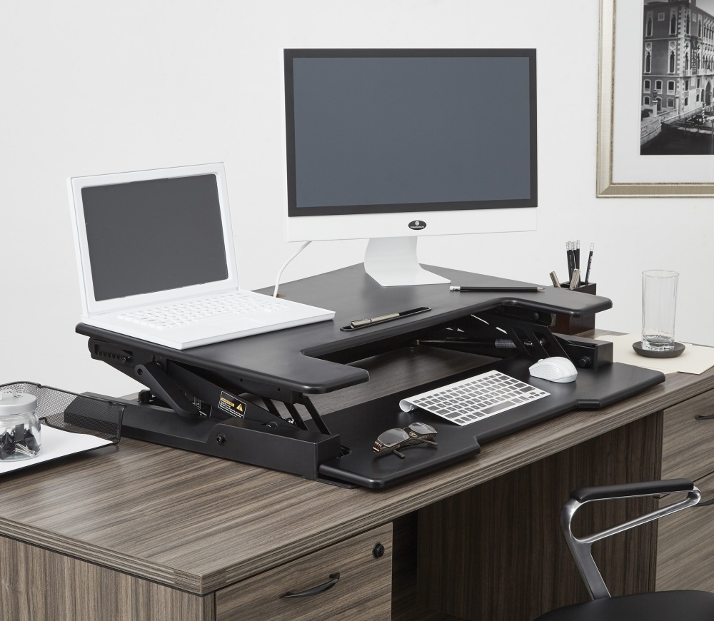 The newest option in standing desk technology is a desk riser that fits right onto your existing desk top surface.