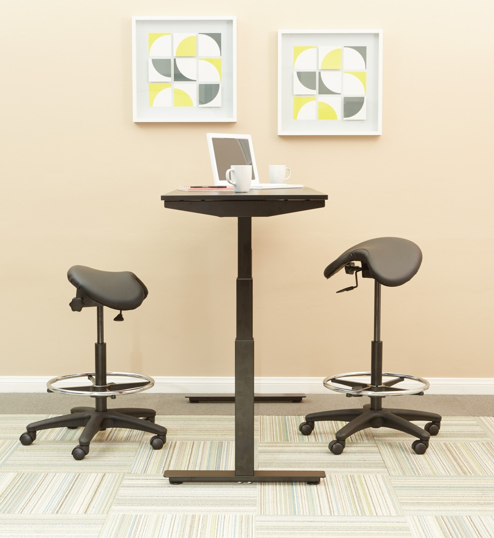 Adopt a sit/partial-stand position while working from your standing desk with an ergonomic saddle seat stool by Work Smart.