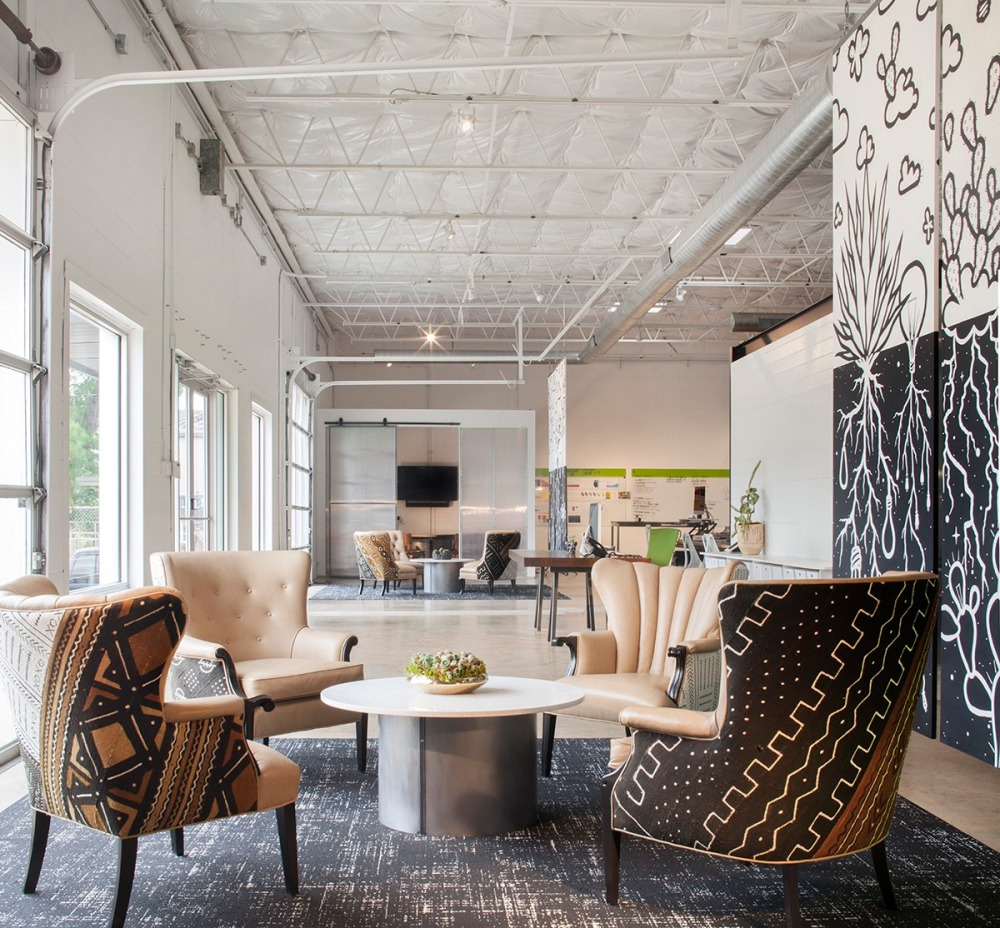 This Dallas company sets the mood as you enter their office with a laid back greeting area to welcome visitors which also doubles as a casual meeting space for staff.