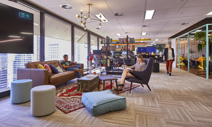 With an eclectic mix of decor and furnishings combined with biophilic design elements, this office goes above and beyond to make staff feel welcome.
